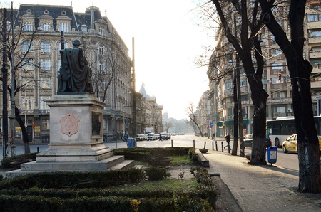 A misty Sunday morning in Bucharest looking down Bulveard Carol from Piata Rosetti to Piata Universitatii Stock Photo