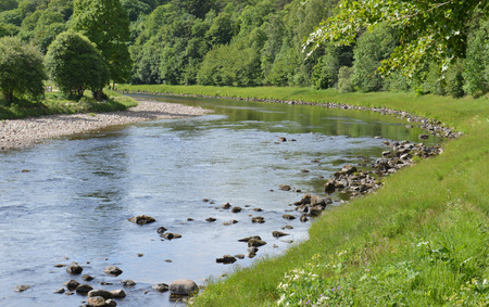 Looking upstream on teh River Dee as it meanders past the oldest village in Royal Desside, Kincardine ONeil.