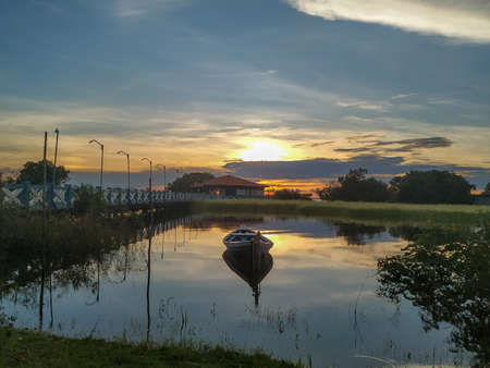 From the banks of the Tapajos rivers in the Alter do Chão region, at the edges of the Amazon River, a beautiful sunset reflected in the magical waters of this river. Stock Photo