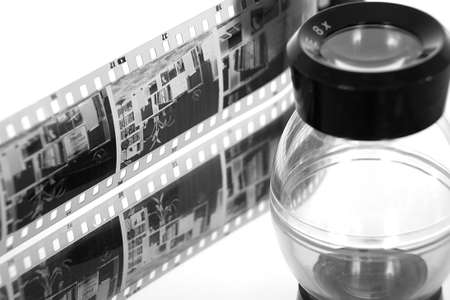 A strip of film negative and loupe