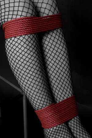 bound woman: Legs tied Stock Photo
