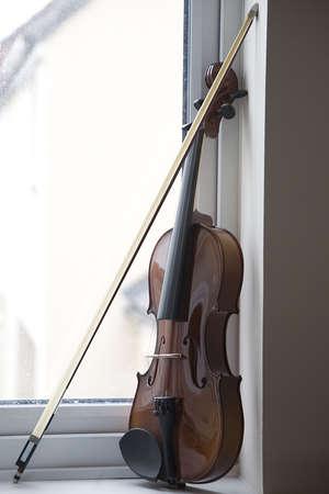 Violin on window ledge