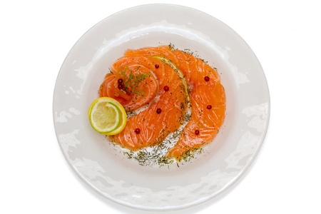 Salmon carpaccio with pink pepper, dill and juice of lemons Stock Photo - 19355059