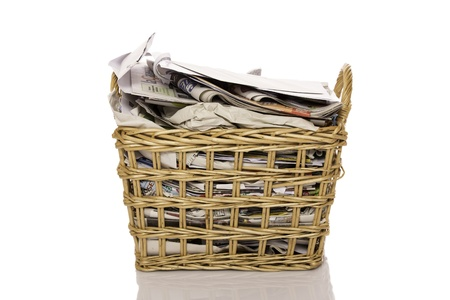 Full wastepaper basket isolated on white background photo