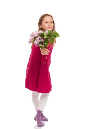 Beautiful young girl with long hair wearing red dress and holding lilac flowers. Isolated on white background. photo