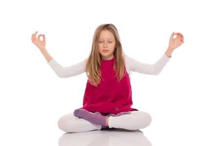 Young girl with long hair wearing red dress and making yoga exercises. Isolated on white background. photo