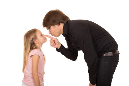 choleric: Despairing father pointing the finger and explains whats wrong to her little daughter Stock Photo