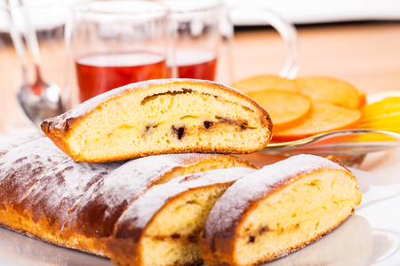 Swiss brioche with chocolate chip, khaki and tea. Stock Photo