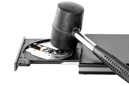 hammer and external CD DVD burner writer isolated on white photo
