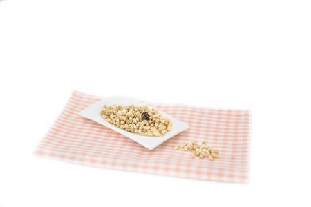 puffed: puffed rice cereal on a plate isolated Stock Photo