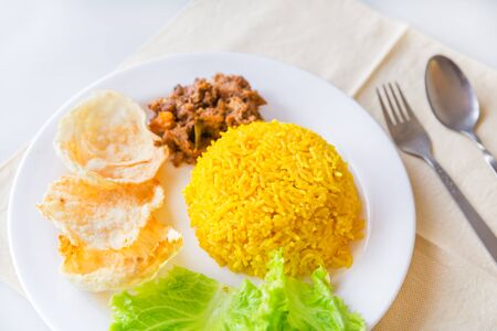 indonesian food: turmeric rice with vegetables and vegetarian rendang, Indonesian food Stock Photo