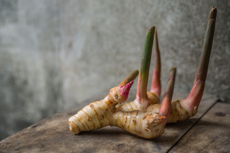 rhizome of galangal on old wooden table
