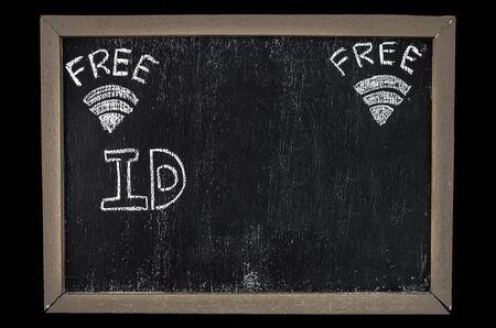 wireless hot spot: Free wifi symbol written on blackboard