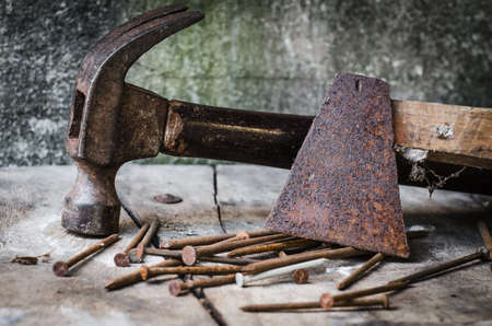 rusty nail: Construction tools,Old rusty axe and old nail claw hammer