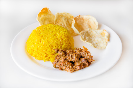 indonesian food: turmeric rice with vegetarian rendang and krupuk, Indonesian food