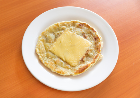 Roti with cheese on white plate, roti prata