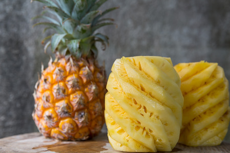 pineapple: Pineapple, peeled pineapple on a wooden background
