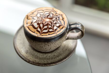 frothy: Cappuccino or latte coffee