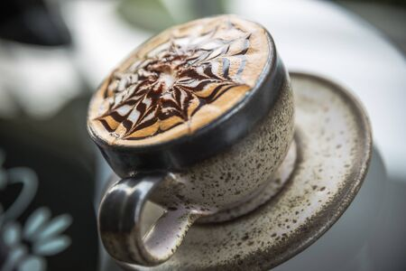 frothy: Cup of latte coffee, Cappuccino or latte coffee cup with art foam