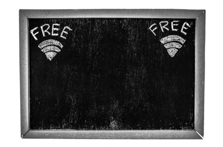 Free wifi symbol written on old blackboard isolated on white background photo
