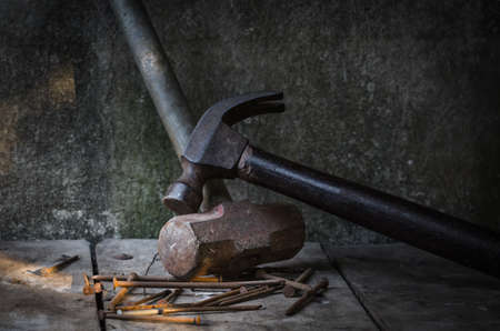hammer head: Hammer head and nails, still life with directional natural lighting for effect