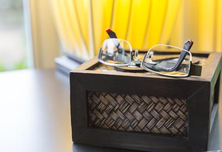 refinement: modern glasses closeup on tissue box