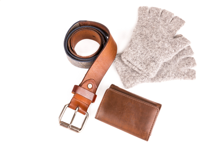 fingerless gloves: vintage leather belt and wool fingerless gloves and wallet on white background