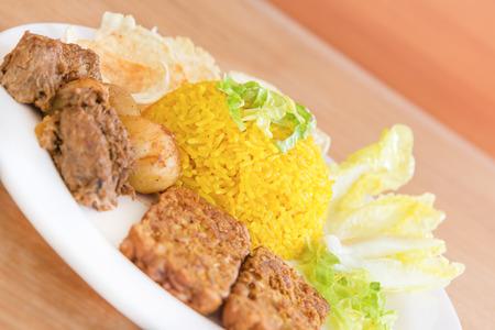 indonesian food: vegetarian rendang with turmeric rice, Indonesian food