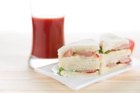 tomato juice: fresh tasty club sandwich with tomato juice and toast
