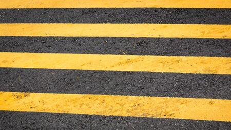 paso de cebra: Crosswalk yellow lines on the road- pedestrian road crossing area