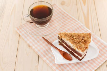 chocolate cake and cup of coffee on wooden background