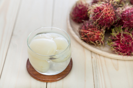 thai dessert: rambutans in syrup with rambutans in a basket Stock Photo