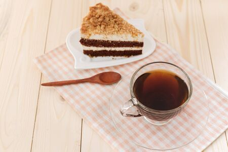 black coffee  and chocolate cake on wooden background