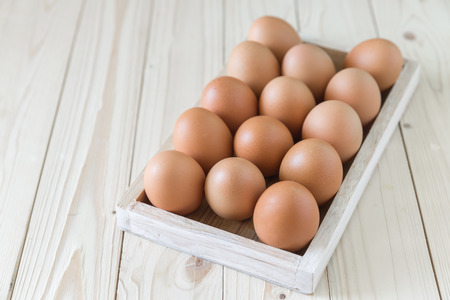 chicken and egg: chicken egg in wood box Stock Photo