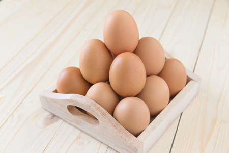 chicken and egg: Eggs, chicken egg in wood box, selective focus