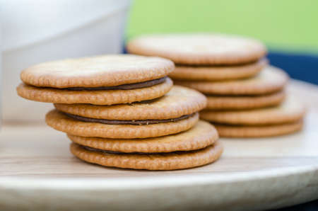biscuts: sandwich-biscuit with chocolate, Sandwich biscuits, filled with chocolate-Selective focus
