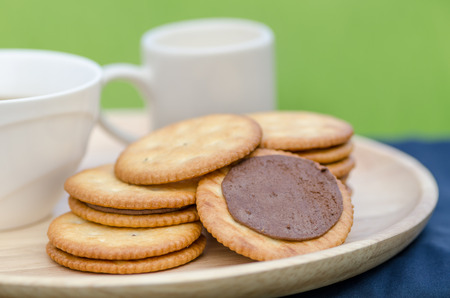 cookies and cream: sandwich-biscuits with chocolate cream and coffee Stock Photo