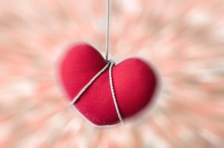 corded: red heart,Corded red heart-radial blur effects Stock Photo