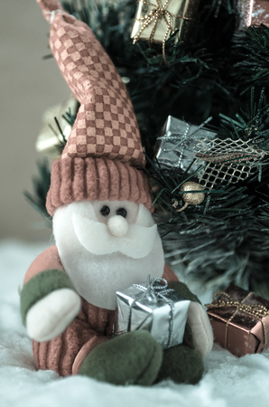 plushie: doll of santa claus and christmas tree in snow:vintage style Stock Photo