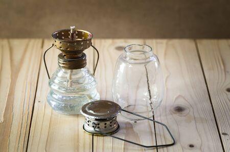 kerosene lamp: still life with kerosene lamp on wooden table,Vintage oil lamp, Vintage kerosene lamp Stock Photo