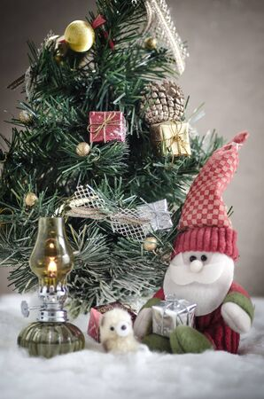 plushie: still life with doll of santa claus and christmas tree in snow