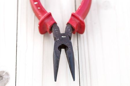 nosed: Pliers tools for electrician on wooden background, A pair of rusty needle nosed pliers