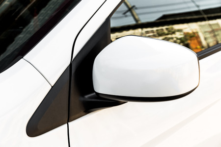 rearview: car side mirror, side rear-view mirror on a modern car Stock Photo