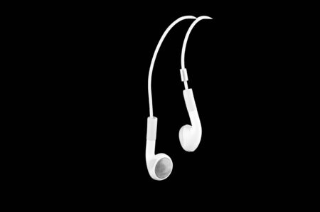 mobile headset: mobile phone headset, isolated on a black background Stock Photo