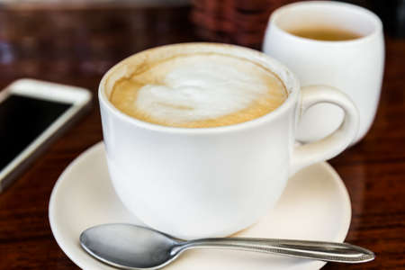 cappuccino cup: cup of cappuccino, cup of coffee, cup of coffee on brown wooden table