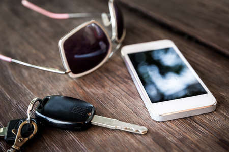 window shades: car key with smartphone and sunglasses - vintage style