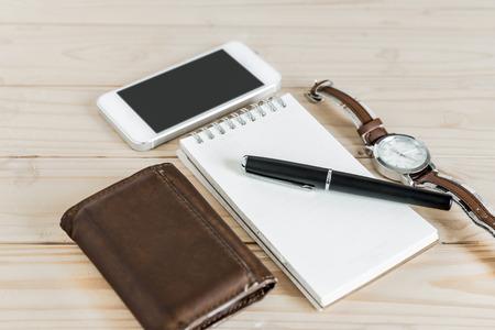 notepaper: businessmans accessories, notepaper, pen, wristwatch, wallet, smart phone Stock Photo