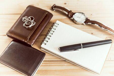 notepaper: Businessmans accessories, notepaper, pen, wristwatch, wallet-vintage style
