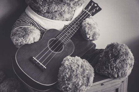 horizontals: Teddy bear playing guitar, vintage style - Selective focus Stock Photo