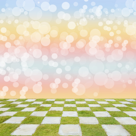 Empty top of grass checkered floor with blurred bokeh background
